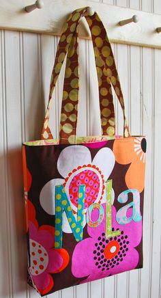 Super cute bag..I love this bag because it reminds me of a friend I lost track of her name was Nola....she saved  my nephews life...he would not eat anything he was 2 days old she came over and tried to nurse him and it worked she saved him.