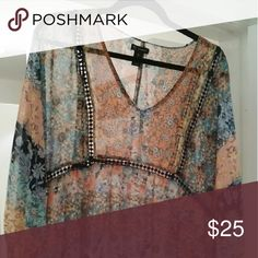 Floral patchwork boho tunic Absolutely cute! Empire seaming with navy lace. It's an XL, but could fit a 1X. Sheer material Tops Tunics