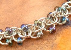 Beaver River // chainmaille silver and purple spiral by DFGjewelry