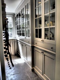 kitchen design floor to ceiling cabinets with glass doors