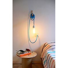 Hanging bulb in turquoise for W's room @ Bo and Dot $75