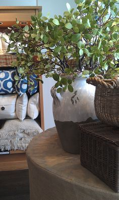 Pottery and wicker is always a great pairing. Throw in natural linens and it's a winning decor.