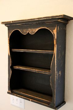 Hello and thank you for stopping by. Here is an adorable sweetheart wall shelf that is distressed to give it that old world charm. This one is distressed black and can be hung on the wall or set on a table.  This shelf measures approximately 21 inches tall by about 20 inches wide and about 5 1/2 inches deep. It has two hangers in the back for easy hanging.  I hope you enjoy looking at it as much as I enjoy making them.  Feel free to email with any questions.