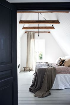 A lovely bedroom featured in interiors book: The Scandinavian Home by Niki Brantmark. Photography James Gardener. Published by CICO Books.