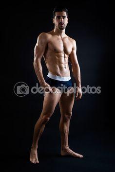Beautiful and muscular man in dark background. — Stockbild #55995159
