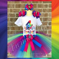 Includes tutu, shirt, and hairbow. Shirt is made with a vinyl image and is personalized with child's name and age at no extra charge. Tutu has an elastic band with 3 layers of tulle to make it extra f