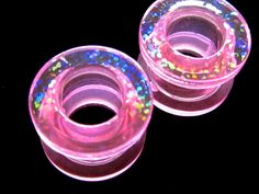 pale pink tunnel plugs with holographic confetti pattern large gauge 10mm (00g). $32.00, via Etsy.