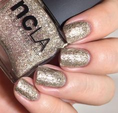 A stunning metallic and shimmering gold glitter polish. A must for the most glam nights out. Grace by NCLA. www.shopncla.com