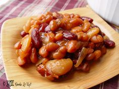 Lumber Jack Baked Beans Time: 15 minutes prep + 1 1/2 hours baking time Yield: 8 servings 8 slices bacon 1 small onion 1 3/4 C brown sugar 1/3 C plus 2 T apple cider vinegar 1 1/2 t dry mustard 1 1/2 t ginger 1 1/2 t salt 1  16 oz. can butter beans 1  16 oz. can pinto beans 1  16 oz. can red kidney beans 1  30 oz. can Bush's Home-style Baked Beans