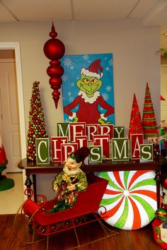 merry christmas blocks under tv stand, grinch party decorations Whoville Christmas Decorations, Grinch Christmas Decorations, Grinch Christmas Party, Christmas Themes, Holiday Fun, Grinch Ornaments, Christmas Blocks, Office Christmas, Christmas Signs