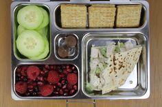 Chicken Salad Pita, Rasberries and Pomegranite, Cucumbers, Crackers and Chocolate