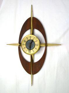 Mid Century Starburst Wall Clock.  I totally want a clock wall someday.