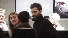 Showing PDA with wife Amelia Warner at LAX.