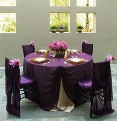 Don't love the table as a whole, but those Eggplant purple tablecloths are gorgeous! And with the gold chivaris... Perfect!