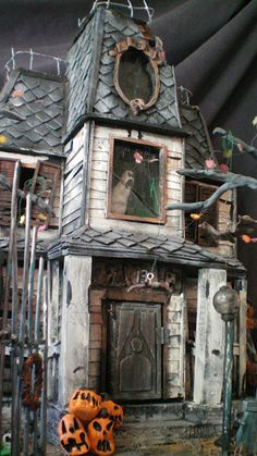I just saw these at a Halloween expo.  Unbelievably detailed haunted houses; they are full of details and creepiness.  I believe it is two brothers; what amazing artists!
