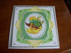This card has been created by using free backing papers and topper from Making Cards Magazine May Edition, Creative Expressions Craft Dies by Sue Wilson - Configurations - Petite Arched Adornment die set, Silver/Yellow/Green card, Creative Expressions Cosmic Shimmer Vintage Holly and Pearl Shimmer PVA glue to form pearls, Tonic Studios Deco Trellis Base die set.