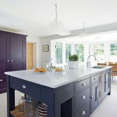 This central island make great use of space. A pantry in a different colour makes a great feature