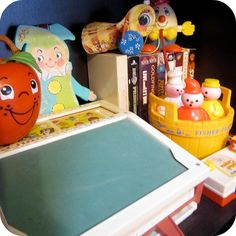 Vintage Fisher-Price toys. I had the apple, the bee, the camera and the chalk board