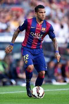 Dani Alves of FC Barcelona runs with the ball during the La Liga match between FC Barcelona and Granada CF at Camp Nou on September 27, 2014 in Barcelona, Catalonia.