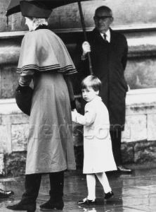 December 25, 1986: Princess Diana with Prince William attending morning service at St. George's Chapel at Windsor Castle. It was the first time Prince William had attended a Christmas Day service, and he looked none to happy as the rain fell outside the church.