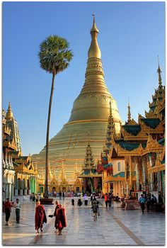 The Shwedagon Pagoda officially titled Shwedagon Zedi Daw, also known in English as the Great Dagon Pagoda and the Golden Pagoda, is a 99 metres gilded pagoda and stupa located in Yangon, Burma. The pagoda lies to the west of Kandawgyi Lake, on Singuttara Hill, thus dominating the skyline of the city. It is the most sacred Buddhist pagoda for the Burmese with relics of the past four Buddhas enshrined within.