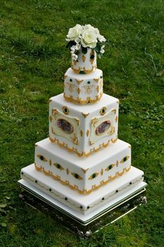 Emeralds, gold gilded lace, and hand painted roses in the plaques wedding cake  ~ all edible