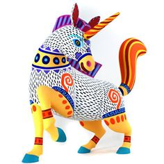 """Alebrijes"" are colorful hand carved hand painted wooden sculptures in animal shapes. They are from Oaxaca Mexico. This one is shaped like a unicorn and I love it! Kunst Der Aborigines, Mexican Designs, Art Lessons Elementary, Paperclay, Naive Art, Mexican Folk Art, Aboriginal Art, Animal Sculptures, Art Plastique"