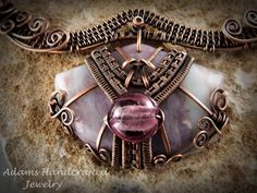 """Hippolyta's Pride -- Once Upon a Time"". Adams Handcrafted Jewelry. A close up view of the Purple Pink Tourmaline Pendant."