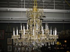 Large contemporary brass and crystal chandelier. Diameter 4 feet, with 24 arms/lights. #antiquelighting #finelighting #brass #interiordesign #design #homedecor #forsale #southernliving #apartmenttherapy #homeandgarden #chandelier #antique #crystal