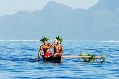 Tahitian in traditional outrigger canoe, French Polynesia