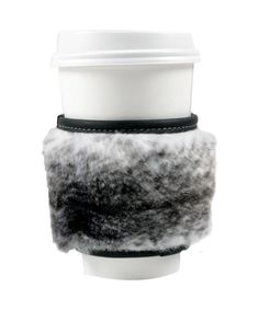 WILLIAM William - The Furcozie No. 1- $115 DESIGNER'S NOTES - exclusively handmade in los angeles- finest faux fur from france- supple leather from america- all furcozies are unique and one-of-a-kind, based on its fur patterns- each will differ slightly than images online- fits standard brand name take away coffee cups- fits standard car cup holders- collapsible into purse and bags, or back of jeans pocket l: 4.25 [10.8cm]w: 4.25 [10.8cm]h: 3.25 [8.3cm]