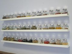 Ikea picture ledges and Rajtan jars full of spices & herbs