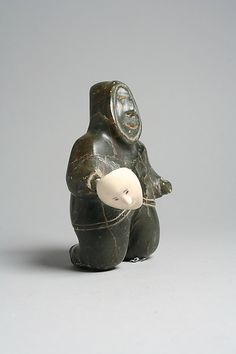 Stone Male in Parka Naomialuk Date: 1950 Geography: Canada, Quebec, Hudson Bay Culture: Inuit Medium: Stone, ivory...