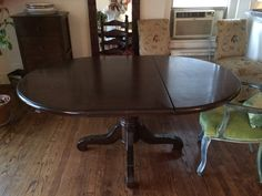 Beautiful Wood Pedestal Table with Extending Leaf by NYCfurnishings on Etsy