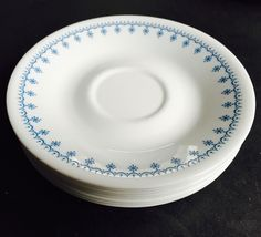 Vintage Set of 8 Corelle Saucers in Snowflake Pattern - Light Blue and White! by TimelessSeconds on Etsy