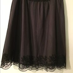 Garnet Hill 3 tier Pleated Skirt Beautiful black lace skirt with light grey under.  100% Polyester. Inner shell 100% silk. Lining 100% acetate. Used only one time. Very good condition. Garnet Hill Skirts Midi