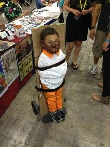 FAIL! Halloween 2013. It's bad enough the parents of this little boy have dressed him as serial killer Hannibal Lecter from Silence of the Lambs, but their real crime in binding their kid so HE CAN'T GRAB ANY CANDY!