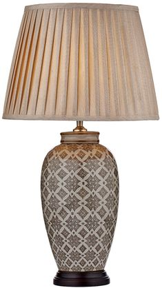 The Dar LOU4229 Dar Louis caramel ceramic table lamp and taupe shade is traditional, featuring a vase shaped ceramic base, with flared brown plinth, glazed caramel geometric pattern and pale cream background colour. Supplied with an elegant tapered taupe faux silk pleated shade.