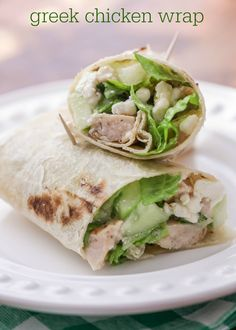 Simple and quick Greek Chicken Wraps - filled with feta, cucumbers, lettuce, chicken and Greek dressing. SO GOOD!