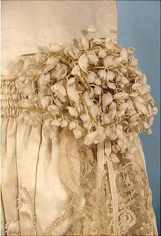 1920s Silk Wedding Dress with Lace and Pearl Detail and Lily of the Valley Decoration at Hip (detail)