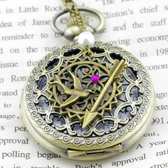 Totally a Hunger Games locket, but love the style!