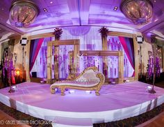Suhaag Garden, Indian Wedding Decorators, Florida Wedding Decorators, Reception Stage, Plum Fuchsia & Lavender Draping, Textured Lighting, Signature Frames, Custom Frames, Pink Orchid Garlands