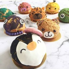 Animals choux 🐷🐽🐯🐸🐧🐥 by @douxamourpatisserie and @anaestheticmind Its so cute!!!! I want this! #choux #amourducake #ours #pig #bear #pinguin #pink #frog #green #brown #black #white #cake #cakes #cakedesign #cakeart #food #foodporn #baker #bakery #pastry #patisserie #tiger #birthdaycake #photooftheday #meringue #macaron #eclair #cupcake