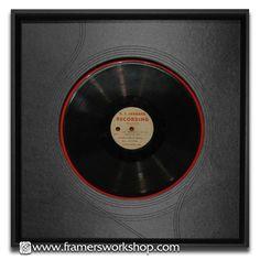 Framed 12 inch vinyl record.