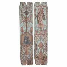 """Showcasing a wood plank design and classical motif, this eye-catching wall decor brings vintage-inspired appeal to your entryway or master suite.  Product: Set of 2 wall decorConstruction Material: WoodFeatures:  Planked designClassical motifDimensions: 56"""" H x 12"""" W x 0.98"""" D each"""
