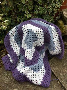 Grey, purple heather and rose tweed aran crochet baby blanket . £28.50, via Etsy.