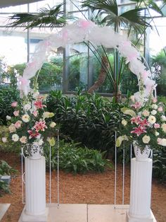 romantic pink and white wedding archway