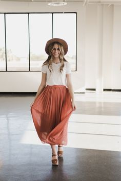 THE PLEATED MIDI SKIRT IN CORAL