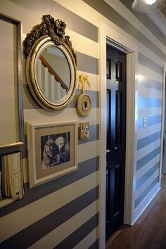 striped walls and black doors
