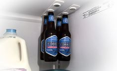 The idea is so simple it's absolutely freaking brilliant: hang your bottles on the roof of your refrigerator using magnets. Between pizza boxes, bottled beverages and leftovers in tupperware contai...